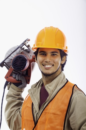latino man: asian hardhat worker with an electric skillsaw