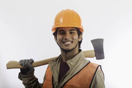 asian hard hat worker with an axe photo