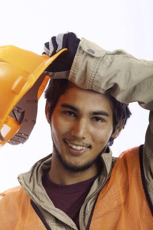 asian latino hardhat worker taking a break 版權商用圖片