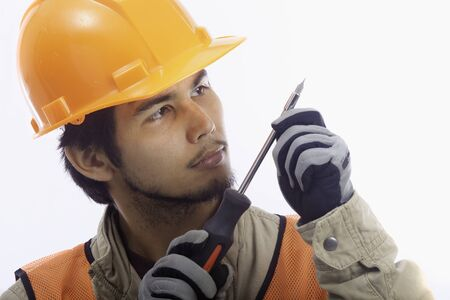 asian latino hard hat worker with his tools photo