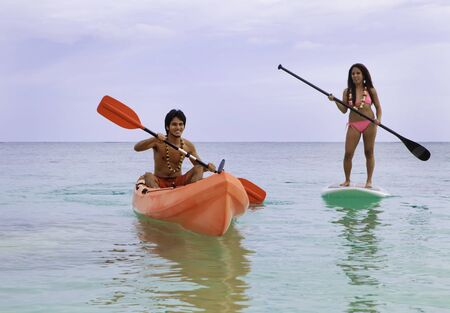 asian couple with kayak and paddle board  photo