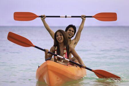 kayak: young asian couple in their kayak in hawaii