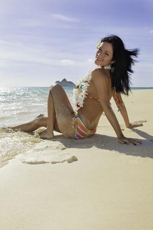 woman in rainbow bikini at a hawaii beach photo