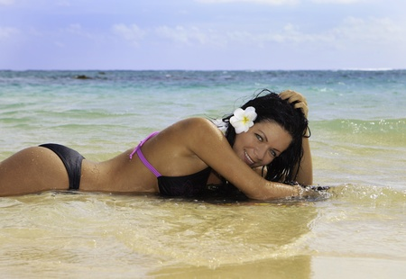 hispanic woman in bikini at a hawaii beach photo