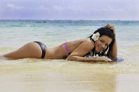 hispanic woman in bikini at a hawaii beach photo