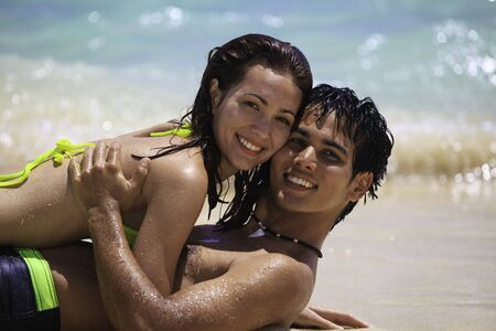 couple playing at the beach in hawaii photo