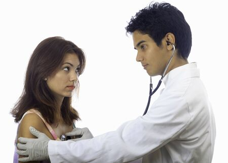 male doctor with female patient having exam