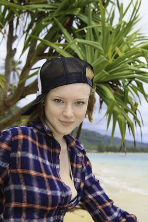 dead trees: portrait of a young redhead on the seashore Stock Photo