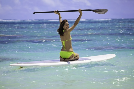 paddleboard: young woman on a standup paddle board