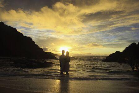 newlywed couple at sunrise on Eternity Beach photo