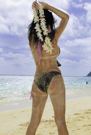 hispanic woman in bikini at the beach  photo