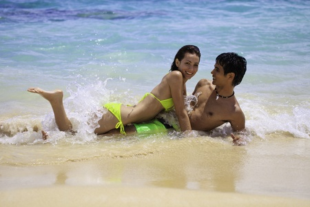 couple playing at the water photo