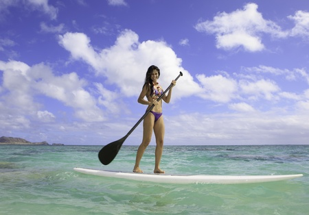 girl in bikini on her stand up paddle board