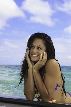brunette in bikini on paddle board in hawaii Stock Photo - 10679307