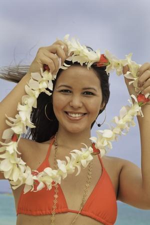fmale: hawaiian woman in bikini with flower lei