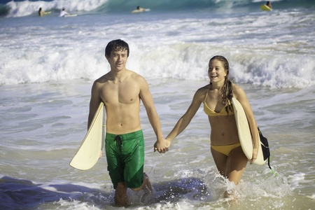 young couple surfing in hawaii Stock Photo - 12137236