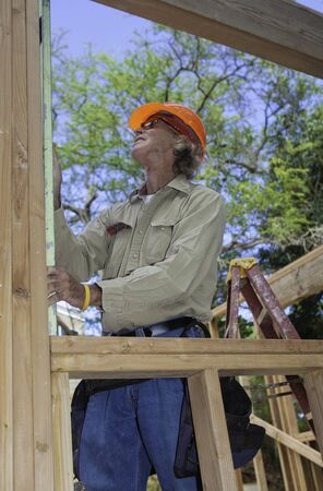male construction worker building a house Stock Photo - 12770744