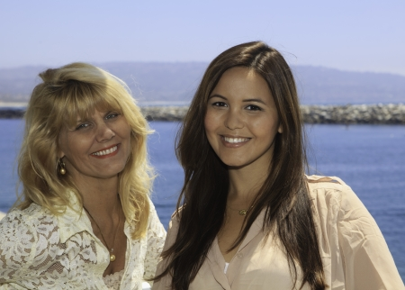 mother and daughter portrait in a  harbor photo