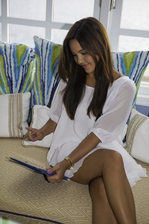 beautiful eurasian girl lounging with her tablet computer Stock Photo - 14025271