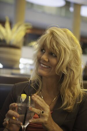 beautiful middle age woman at a restaurant photo