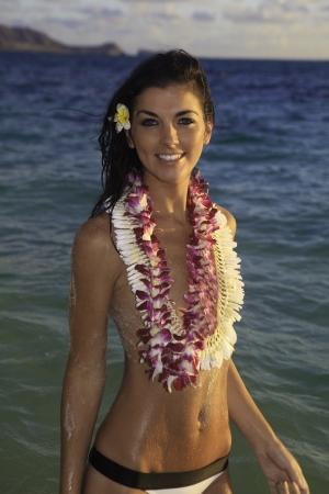 beautiful woman in the ocean at a hawaii beach Stock Photo