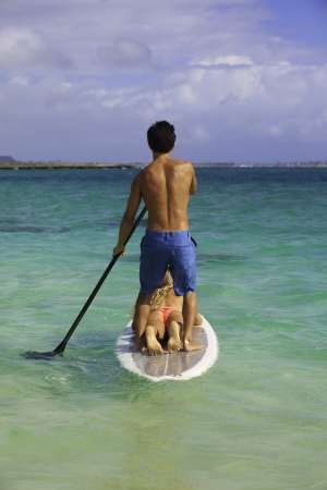 couple on standup paddle board in hawaii Stock Photo - 14838073