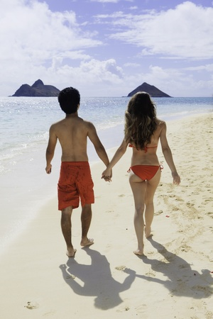couple walking on a hawaii beach photo