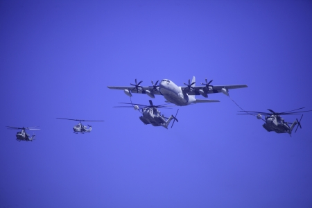 fueling: C-130 refuels Sea Stallion helicopters at airshow