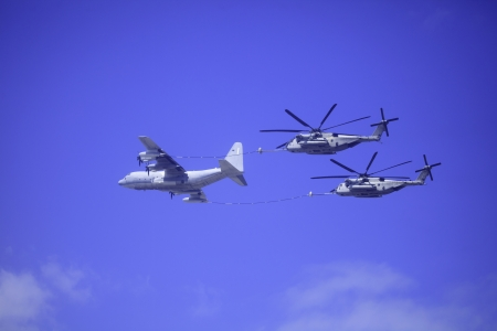 air demonstration: C-130 refuels Sea Stallion helicopters at airshow