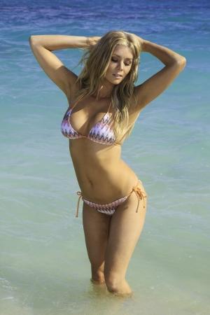blonde bikini: beautiful blond in bikini at a hawaii beach Stock Photo