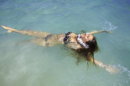 beautiful girl in bikini in the ocean photo