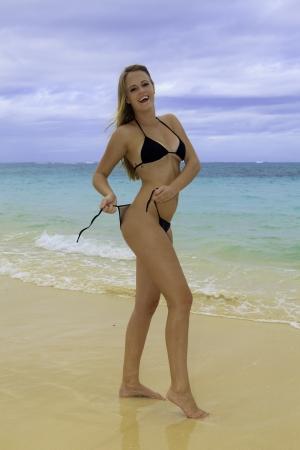blond girl in bikini on a hawaii beach