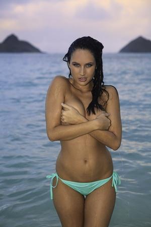 topless: beautiful topless girl in bikini on the beach Stock Photo