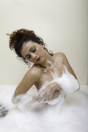 sexy bath: beautiful brunette girl taking a bubble bath
