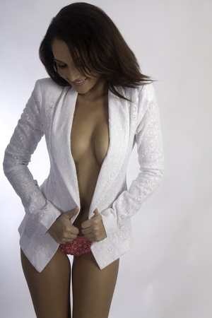 beautiful brunette topless with a white sport coat photo