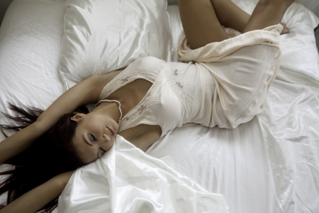 boudoir: beautiful woman wearing negligee in her bedroom