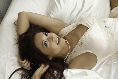 negligee: beautiful woman wearing negligee in her bedroom