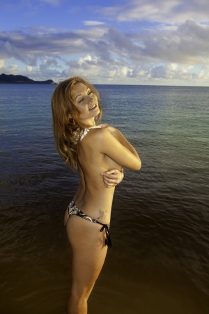 beautiful redhead topless in the ocean in hawaii photo