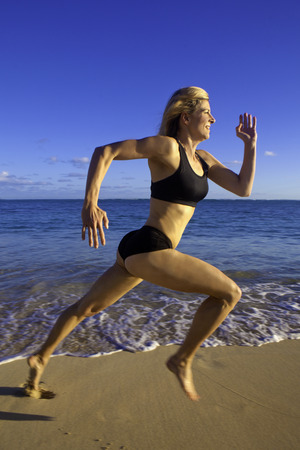 40s: fit woman in her forties on a hawaii beach