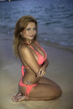 girl in pink bikini at the beach at sunset Stock Photo - 25173046