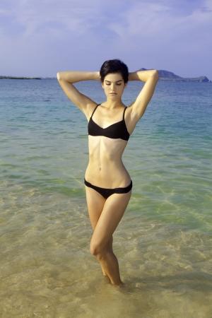tall girl in bikini at a hawaii beach