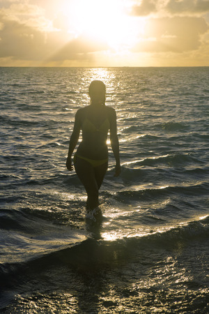 beautiful girl at the beach at sunrise in hawaii photo