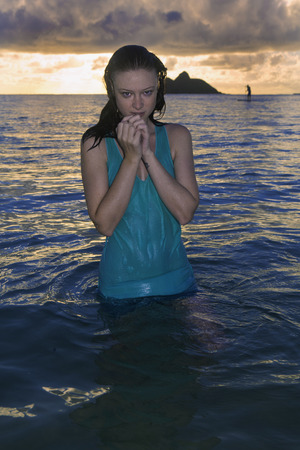 wet dress: girl in a dress in the ocean in Hawaii at sunrise