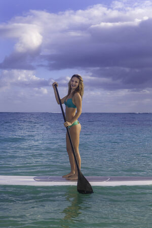 paddling: beautiful girl with stand up paddle board Stock Photo