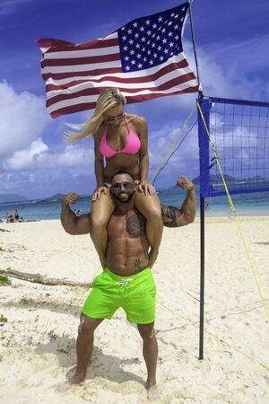 hawaii flag: fit couple at the beach in hawaii
