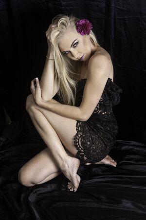 black satin: beautiful blond girl on black satin