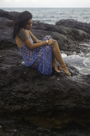 lava: woman on lava rocks by the ocean