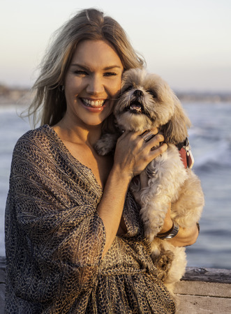 smiling woman with her shitzu dog
