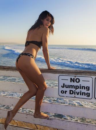 beautiful woman in bikini at pacific beach pier