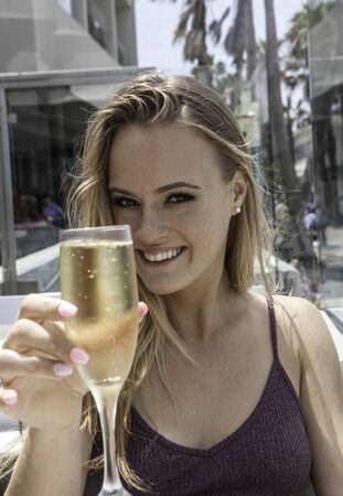 beautiful blond woman with a glass of champagne
